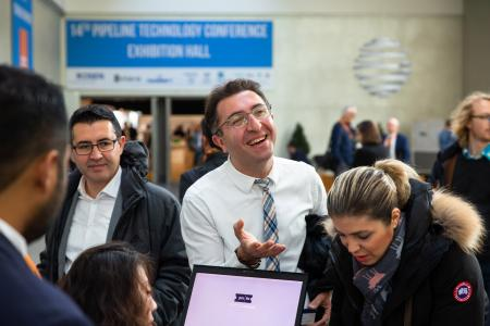 People meeting each other at the registration desk of the 14th Pipeline Technology Conference 2019 in Berlin